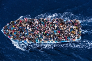 4/Hundreds of refugees and migrants aboard a fishing boat are pictured moments before being rescued by the Italian Navy as part of their Mare Nostrum operation in June 2014. Among recent and highly visible consequences of conflicts around the world, and the suffering they have caused, has been a dramatic growth in the number of refugees seeking safety by undertaking dangerous sea journeys, including on the Mediterranean. 